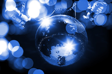 Blue disco background with mirror ball and lights