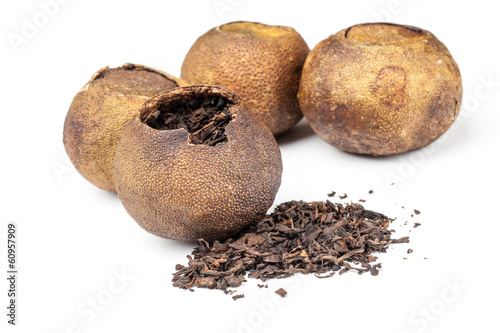 Chinese black tea Pu-erh packed in dried mandarins isolated
