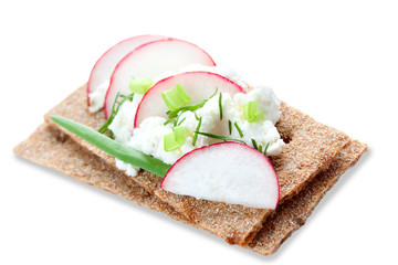 crispbread with cheese and radishes, isolated
