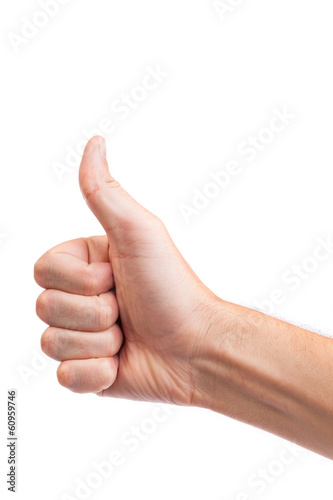Male hand showing thumbs up sign isolated on white