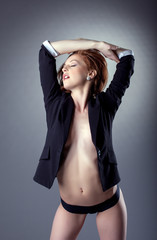 Portrait of excited topless girl posing in jacket