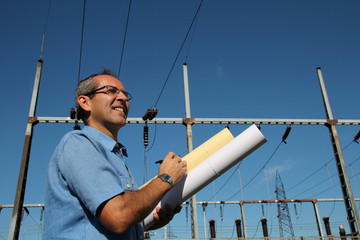 Happy Engineer Next to Electrical Substation.
