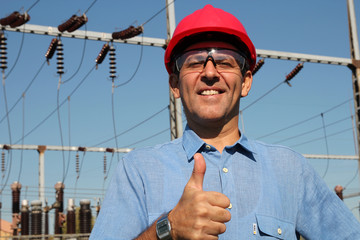 Successful Engineer in Red Helmet Showing Ok Sign.