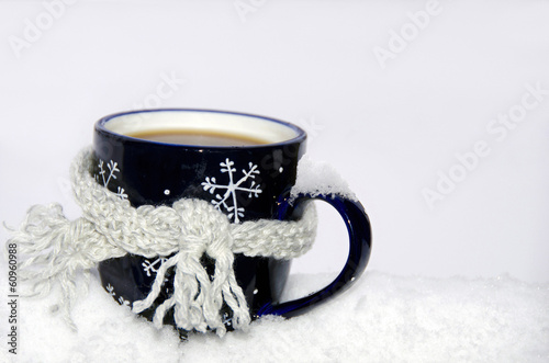coffee mug in snow with scarf