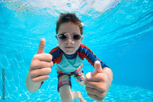 Boy swimming underwater - 60962753