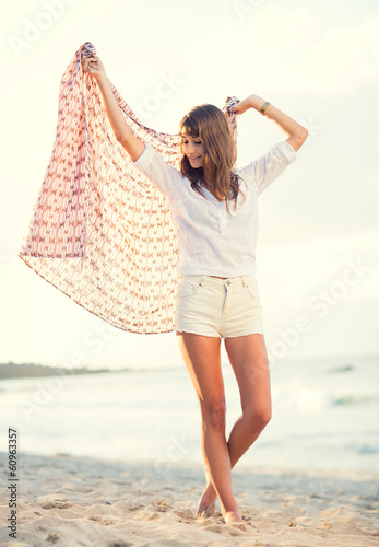 Fashion lifestyle, beautiful young woman on the beach at sunset