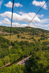 Cable cart aerial view of fields and trees at Matlock