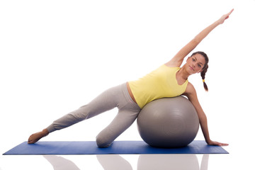 attractive woman exercising with exercise ball