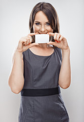 Business woman credit card hold. Gray dress business model posi