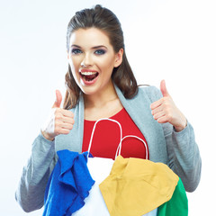 Portrait of happy smiling woman hold shopping bag with clothes.