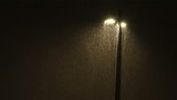 Lamppost in evening in heavy snowstorm