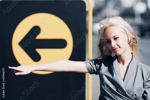 Young business woman pointing a direction