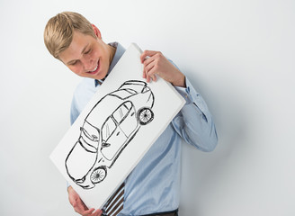 Young businessman holding sign with car sketch. Automobile deale