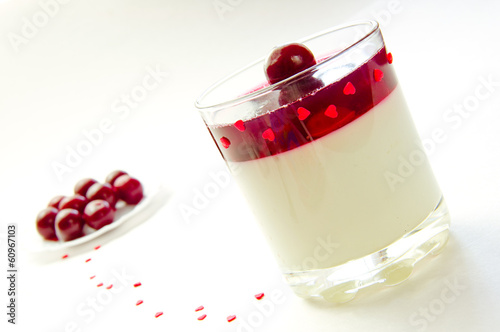 cherry jelly in a glass and cherry in a plate on white backgroun