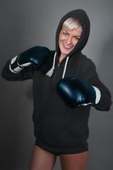 smiling girl in boxing gloves