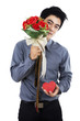 Romantic man with a gift box and flowers
