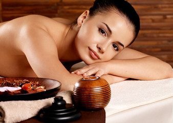 Calm woman relaxing in spa salon