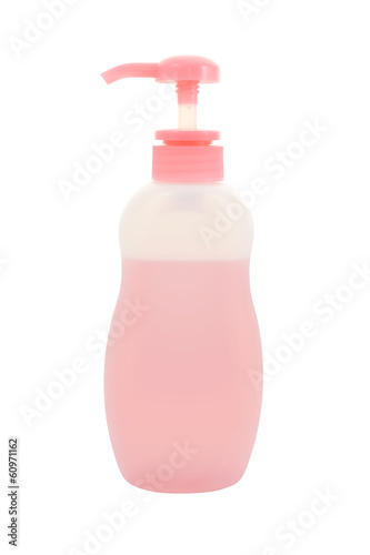Plastic bottle dispenser pump with liquid on white background.