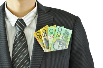 Autralian dollar banknotes in the suit pocket