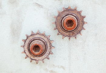closeup of two rusty gears on dirty wall with copy space