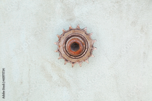 closeup of rusty gear on dirty wall with copy space