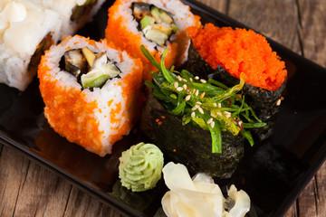 Maki Sushi on wooden background