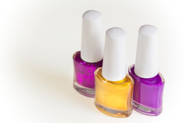 Purple and gold nail polish