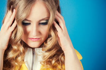 frustrated young woman on blue background