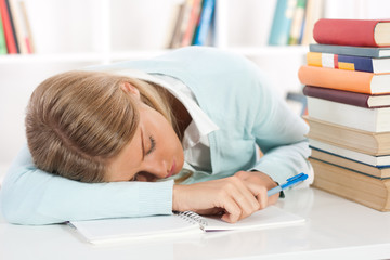 Student feel asleep after long and stressful learning