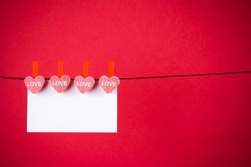 decorative red hearts with greeting card on red background