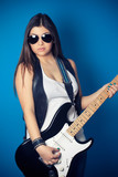 beautiful young woman wearing sunglasses with guitar
