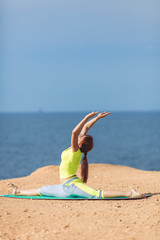 Woman yoga. Series. Outdoor. On the seashore