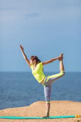 Woman yoga. Series. Outdoor. On the seashore