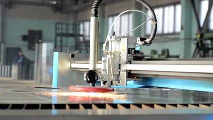 Laser cutting of metal sheet with plasma torch