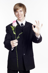 Man with rose showing hand ok sign