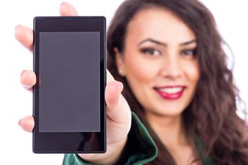 Beautiful young girl showing her smart phone screen