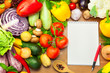 Fresh Vegetables on Wooden Background and Notebook