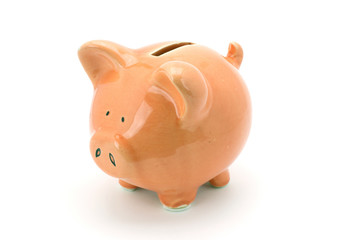 Pink piggy bank standing on a white background.