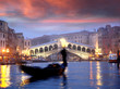 Venice with gondola against Rialto bridge in Italy