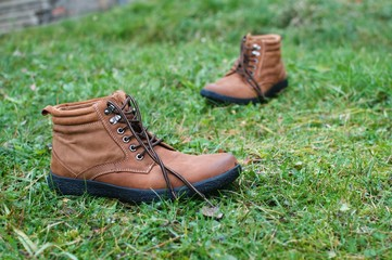 Brown leather boots in the grass