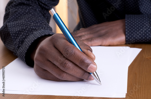 Man writing with a pen