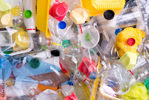 Plastic bottles and containers prepared for recycling - 60981132