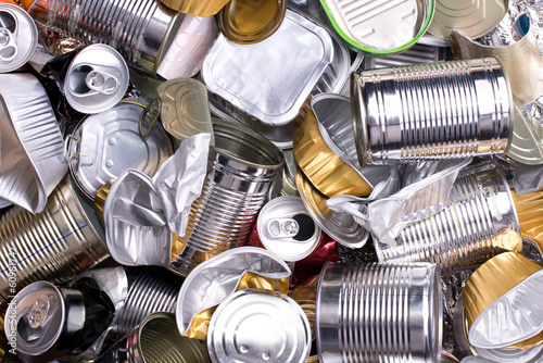 Metal cans and tins prepared for recycling - 60981742