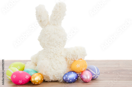 white fluffy easter bunny with eggs