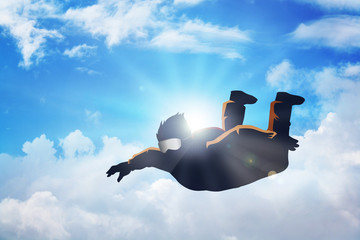 Silhouette illustration of a sky diver