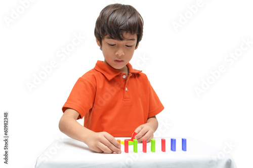 Little  boy use laptop for education on white background
