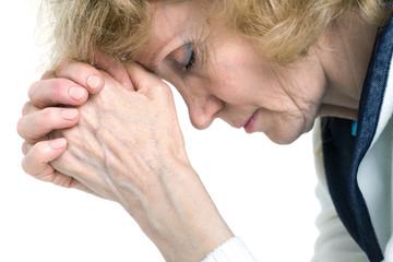 praying senior woman