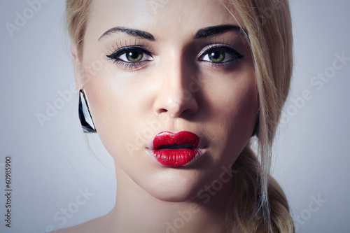 Beautiful Blond Woman with Unusual Make-up.Freak Girl