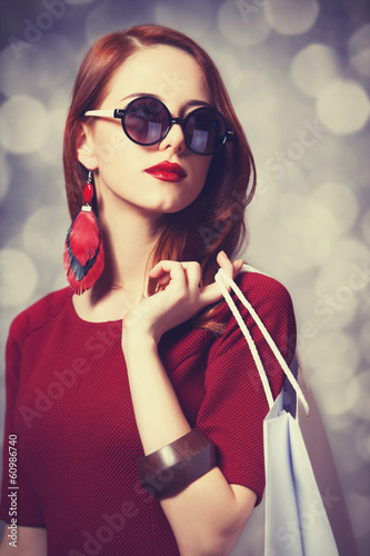 Beautiful redhead women with shopping bag