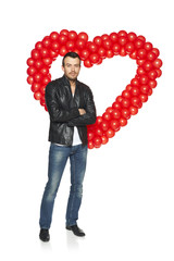 Man standing in front of heart shape